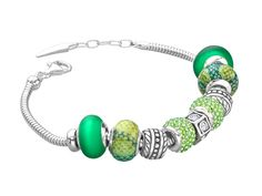 A modern, contemporary charm bracelet will make any eye-catching addition to any ensemble. Sterling silver bracelet features a series of unique beads crafted from bright, spring-inspired green Murano glass and meadow Swarovski crystal strung along a snake chain complete with a lobster clasp closure. Piece measures 7 1/2 inches in length.