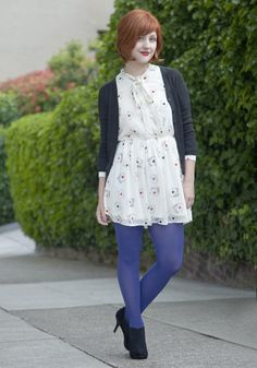 The blue tights make this outfit perfect.