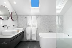 Skylit ensuite w bath, rain shower & twin vanity