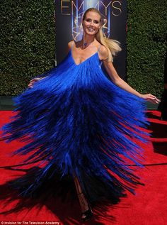 Up and away: Heidi Klum wore a loud royal blue dress for her turn on the Creative Arts Emmy Awards red carpet
