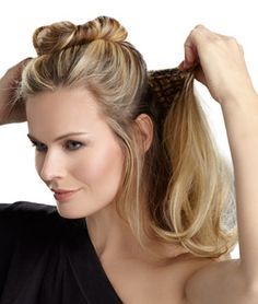 Multi-level, 20in wavy one piece clip-in extension that creates easy, fashionable style without the hassle of working with several individual wefts. Short hair transforms into luxurious below the shoulder length hair. Long hair becomes thick and full. Clip-in for length and volume.   Available in 11 Salon inspired colors.