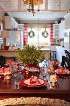 dining room and kitchen decorated for Christmas - vintage Santa mugs are charming. I am now on a hunt to find some!