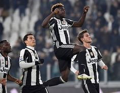 Juventus' Moise Kean celebrates with teammates at the end of the match.