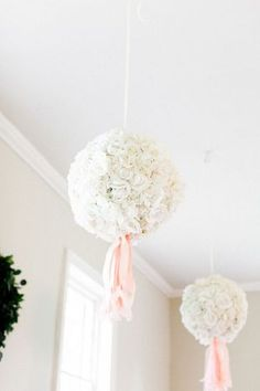 18 Unique Flower Decor Ideas for Your Wedding: White carnation pomanders + pink tassels {The Happy Bloom}