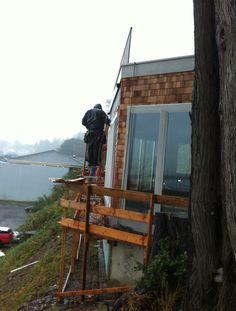 Siding installation and deck handrail. 19 Oct 2012 Pacific Maritime & Heritage Center, Newport, Oregon Photo by Steve Wyatt