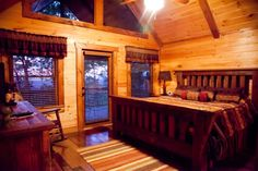 One of the three tastefully decorated bedrooms of A Bears Lair! One bdrm on each level, www.mtngetawaycabins.com