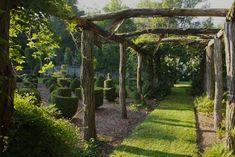 Log pergola // Via Gardenista.  A Secret Garden: Fanciful Topiary in the Berkshires Gardenista