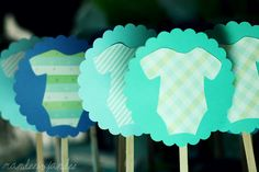 Use a scallop punch then trace the shape of a onesie and glue together on a craft stick to make cupcake toppers.