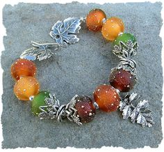 Silvered Maple - Beautiful Artisan Lampwork Beaded Bracelet. This design already sold... but I just had to share... isn't it gorgeous?  To see more of our artisan beads and jewelry, visit out website    www.javabead.com   I might be able to make something similar just for YOU!! :)