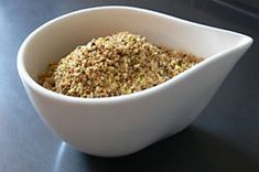 Dukkah nut and spice blend. Use it  as a crunchy coating for chicken or fish or with bread and olive oil. Our Dukkah recipe uses hazelnuts and pistachios.