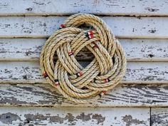 The handmade experts at HGTV.com share easy step-by-step instructions on how to tie a nautical-themed rope wreath.