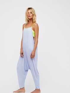 Right On Time Romper | Ultra cool and relaxed, this effortless romper features a dropcrotch fit with a slight cropped leg. Open back detail.