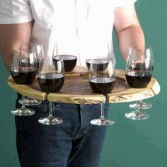 A safe way to carry wine for your guests without holding you breathe and fearing dropping a glass!