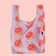 Grapefruit Standard Baggu  The Baggu Reusable Bag is an environment-friendly, colorful way to not use plastic bags. Ideal for the grocery store or lugging stuff around for the day, the Baggu Reusable Bag is a simple design that goes a long way. It also comes with a small pouch so you can fold it up, tuck it away, and bring it along anywhere.  100% ripstop nylon. Machine washable. Folds into flat 5 inches by 5 inches carrying case, included.