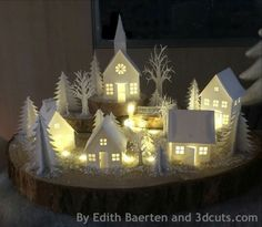 Here is another holiday paper project. This is the 3dcuts.com Tea Light village made by Edith Baerten. Such a beautiful paper project.
