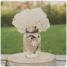 mason jar with a burlap heart. Green wedding. Upcycle wedding. Vintage chic wedding. Wedding reception decor ideas. Easy DIY wedding decorations. Wedding flowers. #DIYwedding #OutdoorWedding #SummerWedding