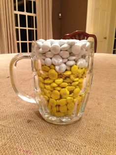 Could use any yellow and white candies. Place these on tables.