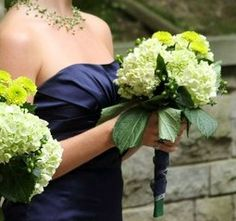 Green pearl necklace, navy dress and green hydrangeas