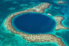 The world's biggest sinkhole in Belize is no stranger to plastic bottles and pollution, as found by Richard Branson who led a diving expedition into The Great Blue Hole. Source: Belize's Great Blue Hole reveals its dirty, little truth Top Travel Destinations, Best Places To Travel, Cool Places To Visit, Places To Go, Belize, Best Vacation Spots, Best Vacations, Vacation Trips, Lonely Planet