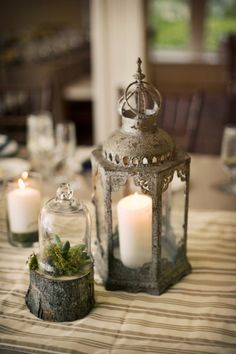 Use a lantern with a terrarium for a beautiful table setting.