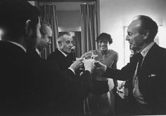 "Ballet dancer Edward Villella (2R) engaging in a champagne toast w. choreographer George Balanchine (R) & three other unident. men in his dressing room after his performance in Balanchine's ""Prodigal Son"" at NY State Theater."