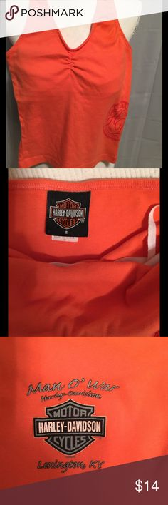 Harley Davidson halter top Harley orange halter top, size S , shelf bra.  Heavy Harley tee fabric, HD graphic on the side and third picture is of the back. No rips, stain, smells.  Great Harley Tee Harley-Davidson Tops Tank Tops