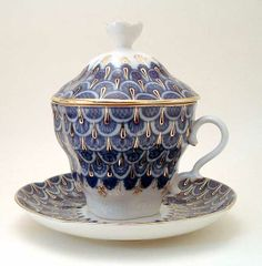 Tea cup with saucer, namvy blue, white with lid and gold trim.