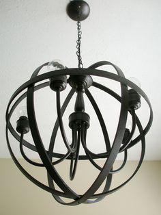 I have really been loving orb chandeliers! I knew I wanted one in our new place, but I didn't have the budget to buy a $1000 chandelier! ...