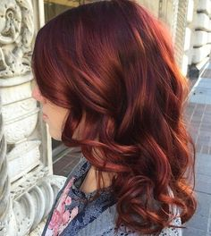 long copper red hairstyle with bangs