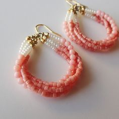Pink coral and glass beads in a four tiered hook earrings. Slow, feminine curves to the ear lobe. Seed Bead Earrings, Pearl Drop Earrings, Beaded Earrings, Earrings Handmade, Beaded Jewelry, Handmade Jewelry, Beaded Bracelets, Unique Jewelry, Pendant Earrings