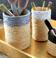 Shipping tubes, hot glue and twine are all you need to make rope-wrapped containers. They're super easy to make, utilize items you most likely already have, and best of all, organize your workspace in a cool-looking way.