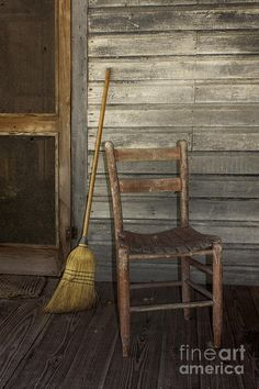 Wonderful screen door, corn broom and an old wicker seated chair...reminds me of the old homestead we lived on.