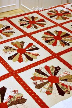 "Dresden Plate Quilt~the one I have that Mom made me is all in shades of purple and has a scalloped bordered.  She always called it my ""childhood illness"" quilt because she'd work on it when I was sick with the Mumps, Chicken Pox, Measles, Scarletina, etc.  (Yes.  I'm THAT old!)"