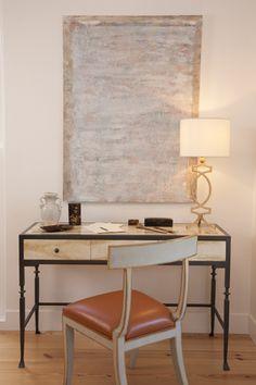 Home Study: Niermann Weeks Elgin Chair in orange leather is pulled up to a Wrought Steel Desk with a Montaigne Table Lamp. niermannweeks.com #NiermannWeeks