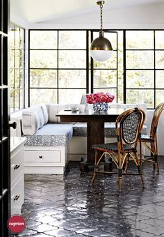 Arabesque black cement tiles, unusual sphere pendant, loft windows, bistro chairs and bud vase.  love!