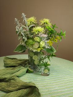"""Mojito"" Inspired Design - lambs ear, mint, hosta, 'Kermit' pompons and limes by Flower Factor, via Flickr"