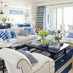 Blue and white never looked so brilliant: California designer Mark D. Sikes switched coasts to take on our Idea House in nautical Newport, Rhode Island. The result is an East-meets-West-Coast stunner that redefines classic coastal style. Blue And White Living Room, White Rooms, Style At Home, Coastal Living Rooms, Living Room Decor, Living Area, Coastal Living Magazine, Rooms Decoration, Coastal Decor