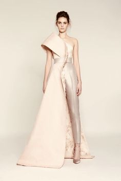 A light pink formal gown-suit hybrid.