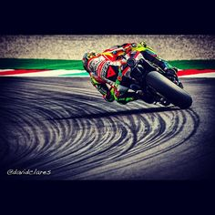 Valentino Rossi, I hate this man with a passion but you can't deny his skill.