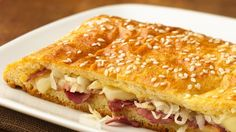 If you're fan of Reuben sandwiches, you'll enjoy a family-size version served hot from your oven and made with Crescent Recipe Creations™ flaky dough sheets.