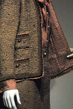 inspiration for a Jean Frost knitted jacket~ Chanel jacket close up showing quilted lining in the collection of the Costume Institute at the Met shown in Threads magazine
