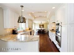 A Realty Executives International Unique Kitchens Listing with a creamy white decor fit for a queen!