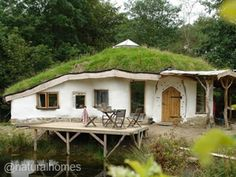 Green Roofs around the World -Charlie's roundhouse in Wales has a reciprocal green roof; a roofing method popularised by Tony Wrench who was one of the many that helped Simon Dale to build his woodland home. Tony's book, Building a Low Impact Roundhouse, details how to build a reciprocal roof.