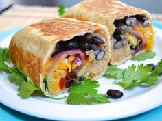 Roasted vegetable burritos stuffed with vegetables, cheese, and cilantro.