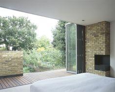 master bedroom opens onto balcony overlooking garden - 2-storey rear extension - PDR - Rylett Road, Chiswick, West London - Mikhail Riches - 2004