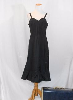 A Vintage 50's black full slip dress / slip by Barbizon.  A great Valentines Day gift or Anniversary gift for her. #women's vintage clothing #women's lingerie #women's #Women #vintage_clothing #vintage lingerie #vintage 1950's #vintage #Valentines Day #sweetheart neckline #side zipper #Lingerie #Gift for her #For Sale #For her #embroidered #boudoir lingerie #Boudoir #black slip dress #black lingerie #black full slip #black #Barbizon #Anniversary #50's lingerie #50's #anniversary gifts…