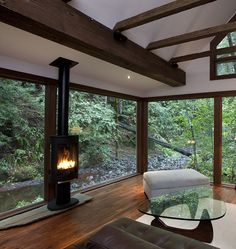 furniture is awful, but I love the beams, windows, and fireplace