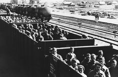 This trainload of men was described by German sources as Soviet prisoners en route to Germany, on October 3, 1941. Several million Soviet soldiers were eventually sent to German prison camps, the majority of whom never returned alive. (AP Photo)