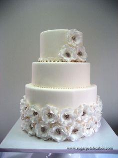 all white open rose wedding cake - very classy