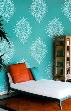 Large bold paisley stencil on turquoise wall. Easy way to transform an accent wall with stencils